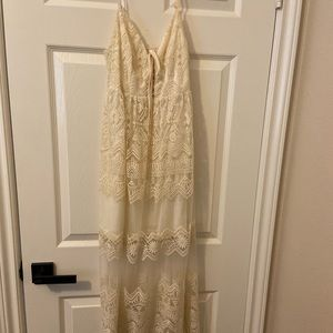 Creme colored spaghetti strap sun dress.